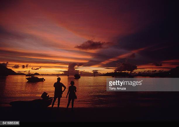 sunset over cane garden bay, british virgin islands - cane garden bay stock pictures, royalty-free photos & images