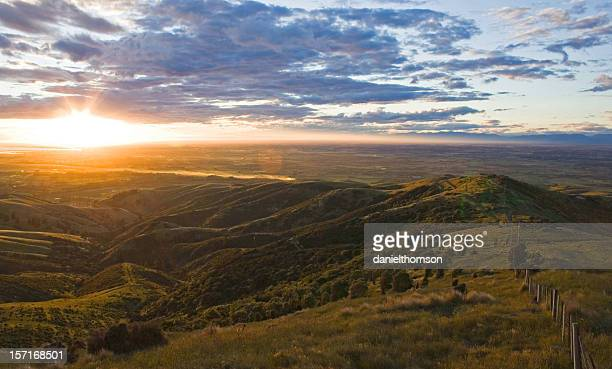 sunset over canterbury plains - christchurch stock pictures, royalty-free photos & images