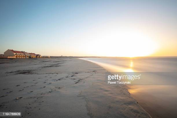 sunset over cape cross seal reserve on the skeleton coast in western namibia near cape cross, namibia, 2018 - scenics stock pictures, royalty-free photos & images