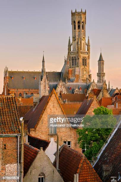sunset over city and belfry of bruges, belgium - bruges stock pictures, royalty-free photos & images