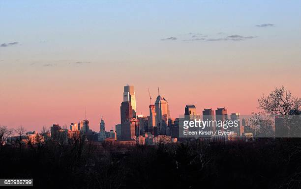 sunset over city - eileen kirsch stock pictures, royalty-free photos & images