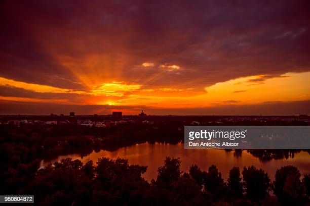 Sunset over cityscape and lake, Bucharest, Romania