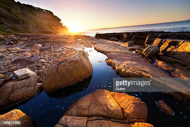 Sunset over coastal rocks