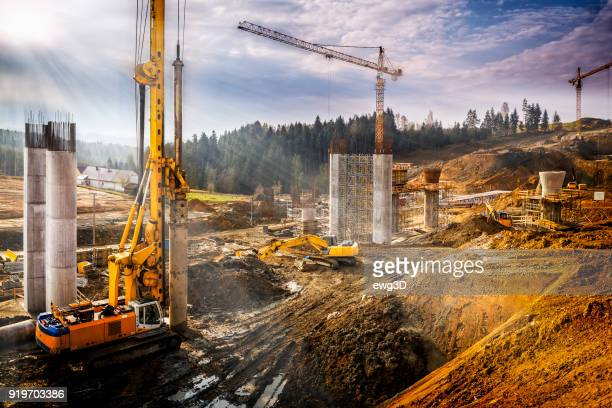 sunset over construction of the viaduct on the new s7 highway, poland - drill stock pictures, royalty-free photos & images