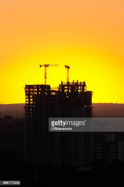 sunset over construction - crmacedonio stock photos and pictures