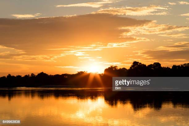 sunset over cubango river, namibia, africa - evening glove stock pictures, royalty-free photos & images