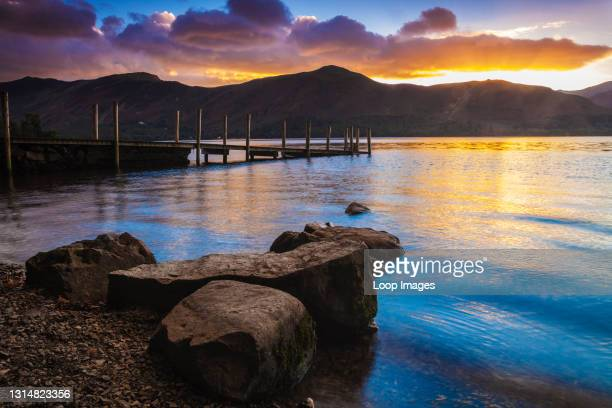 Sunset over Derwent Water from Ashness landing stage in the Lake District.