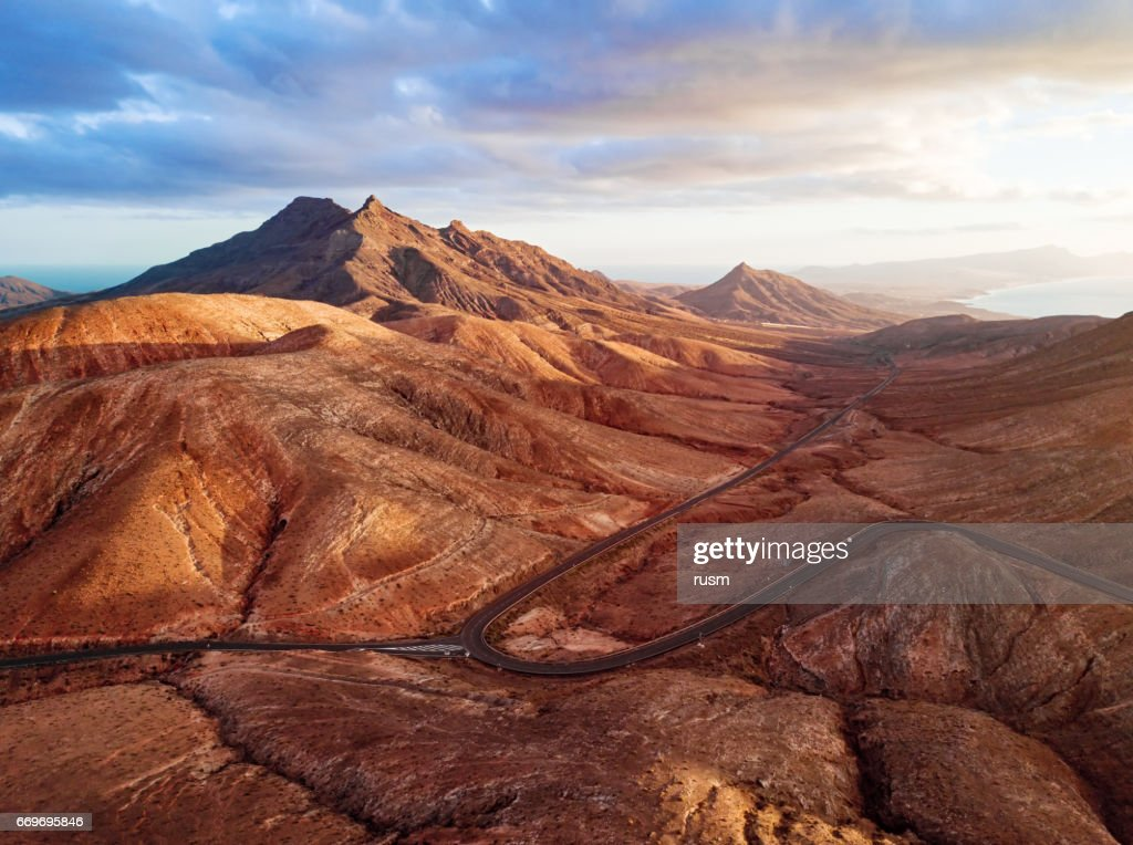 Sunset over desert landscape of Fuerteventura, Canary islands : Stock Photo