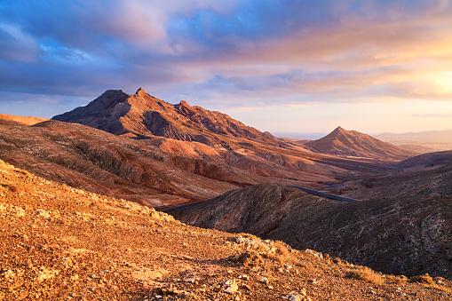 Sunset over desert landscape of Fuerteventura, Canary islands 913790238