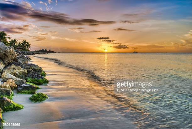sunset over dickenson bay - antigua & barbuda stock pictures, royalty-free photos & images