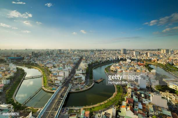 sunset over downtown saigon - the biggest city in vietnam - people's committee building ho chi minh city stock pictures, royalty-free photos & images