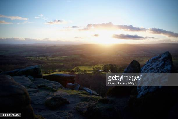 sunset over dramatic moorland brimham rocks - harrogate stock pictures, royalty-free photos & images