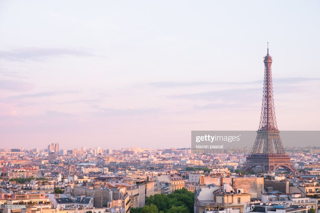 sunset over Eiffel tower in Paris , France : Stock Photo