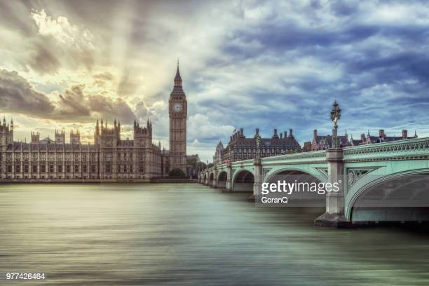 sunset over famous houses of parliament in london, uk. - westminster bridge stock pictures, royalty-free photos & images
