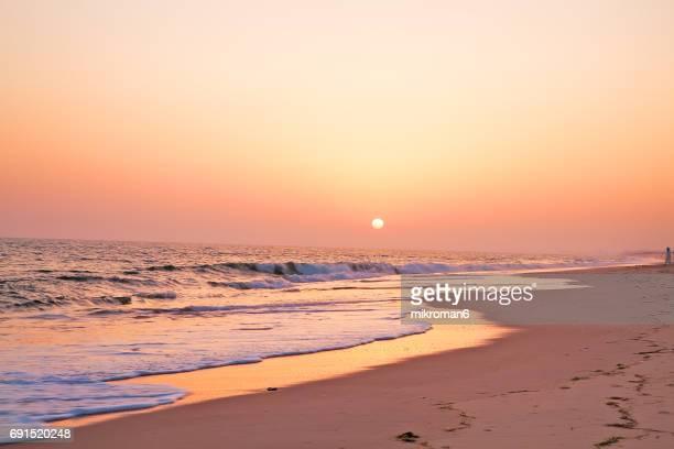Sunset over Faro beach. Praia de Faro, Faro, Portugal