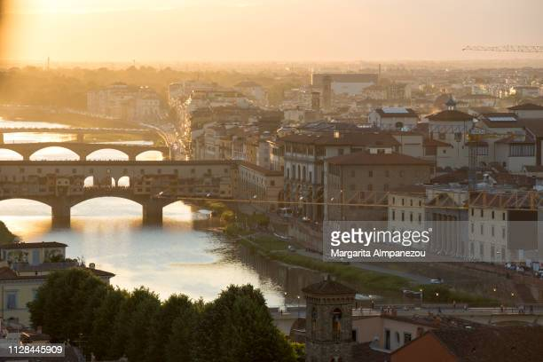 Sunset over Florence city with Arno river and Ponte Vecchio views from above