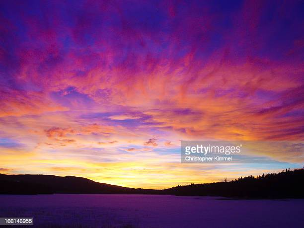 sunset over frozen lake - kamloops stock pictures, royalty-free photos & images