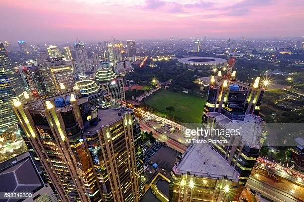 Sunset over GBK stadium and Jakarta Skyline, Sudirman Road Area. Jakarta, Indonesia.