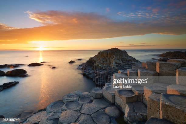 sunset over giant's causeway, county antrim, northern ireland, uk - giant's causeway stock pictures, royalty-free photos & images