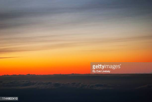 sunset over gray clouds aerial view - sky only stock pictures, royalty-free photos & images