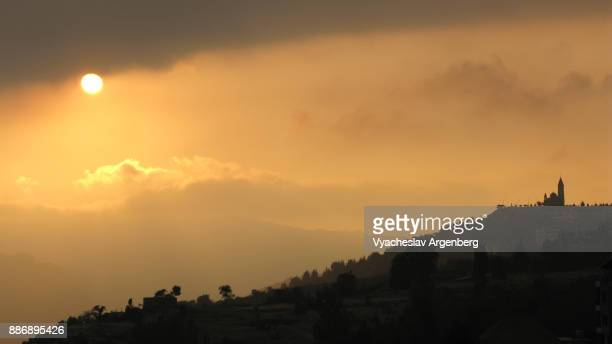 sunset over hadchit village as seen from bsharre, lebanon - argenberg stock pictures, royalty-free photos & images