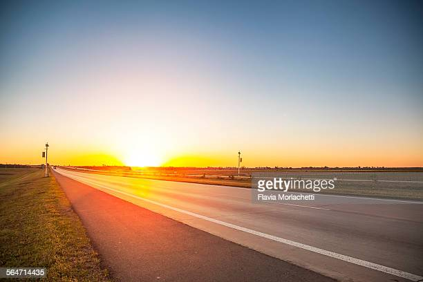 sunset over highway - cordoba argentina stock pictures, royalty-free photos & images