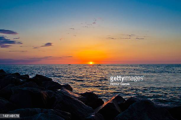 sunset over holland beach - rolour garcia stock pictures, royalty-free photos & images
