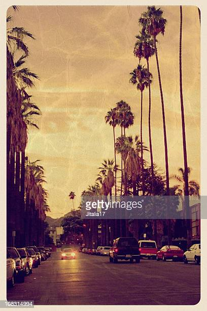 sunset over hollywood hills - vintage postcard - boulevard stock pictures, royalty-free photos & images
