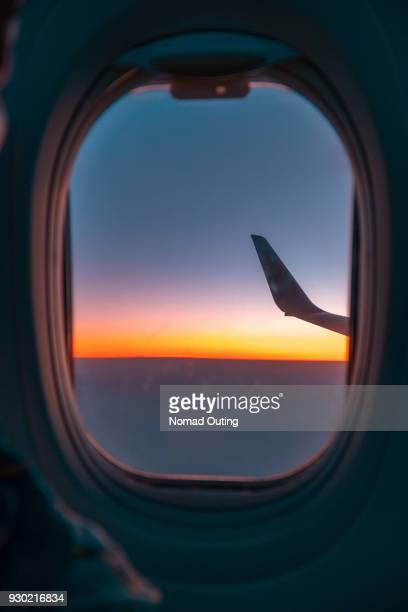 Sunset over horizon,looking through from airplane window.