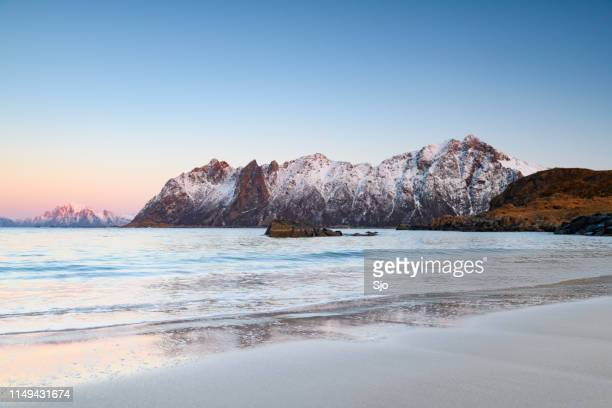 Sunset over Hovden beach at the Vesteralen archipel in Northern Norway during winter