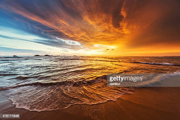 sunset over indian ocean - non urban scene stock pictures, royalty-free photos & images