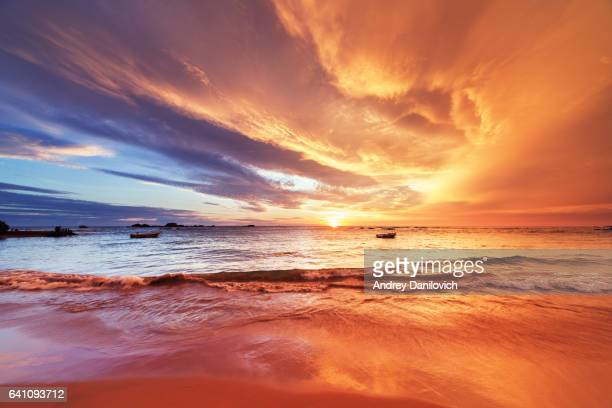 sunset over indian ocean - dramatic sky stock pictures, royalty-free photos & images