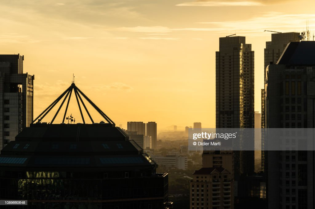 Sunset over Jakarta business district in Indonesia capital city. : Stock Photo