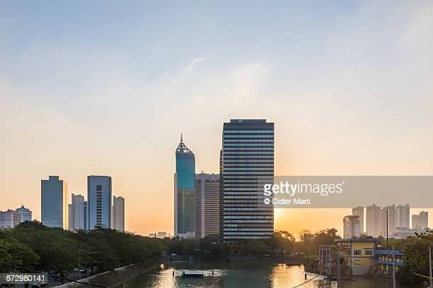 sunset over jakarta, indonesia capital city - emerging markets stock photos and pictures