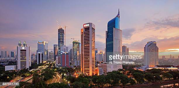 sunset over jakarta skyline, capital city of indonesia. jakarta, indonesia. - java indonesia fotografías e imágenes de stock