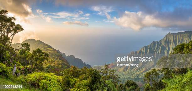 sunset over kalalau valley - na pali coast stock pictures, royalty-free photos & images