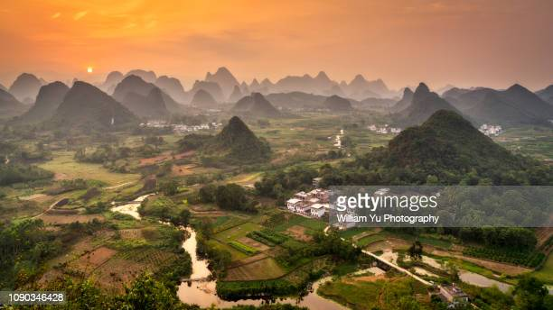 Sunset over karst hills and terraces of Guilin