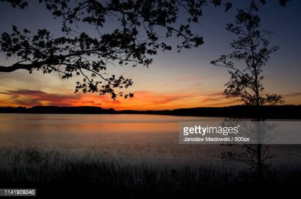 sunset over lake and reel, poland, masuria - maslowski stock-fotos und bilder