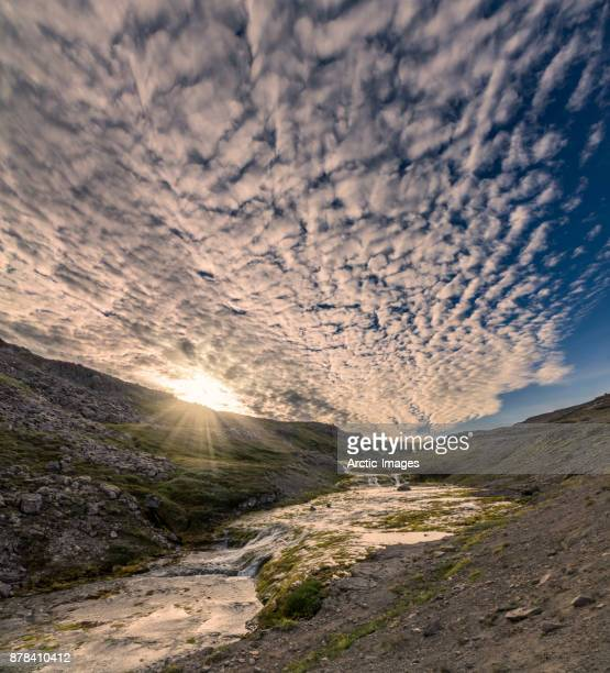 sunset over landscape, iceland - altocumulus stockfoto's en -beelden