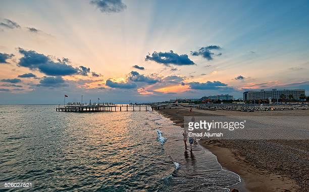 sunset over lara beach, antalya, turkey - antalya stock-fotos und bilder