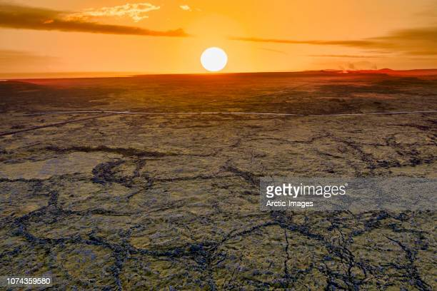 sunset over lava and moss landscape, iceland - geology stock pictures, royalty-free photos & images