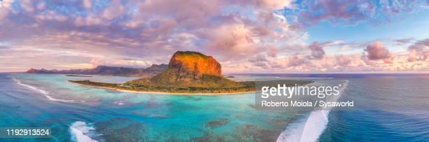 sunset over le morne brabant peninsula and coral reef, aerial view, mauritius - islas mauricio fotografías e imágenes de stock