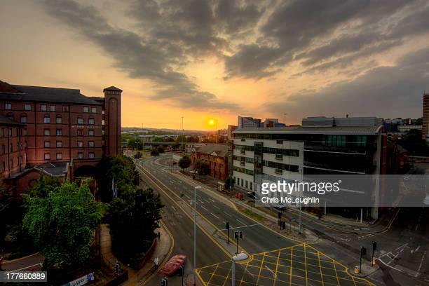sunset over leeds city centre - leeds city centre stock photos and pictures