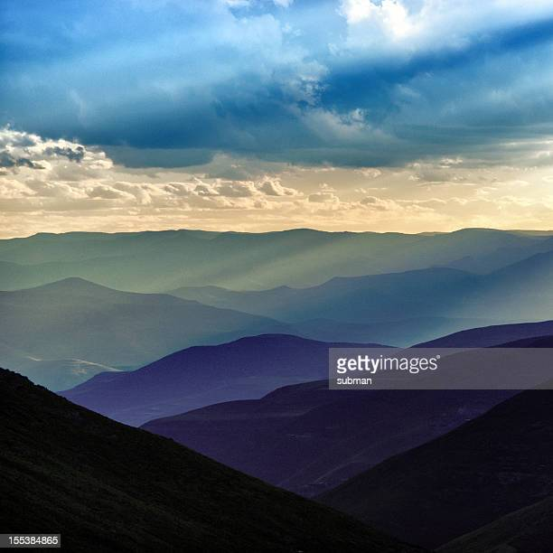 sunset over lesotho mountains - lesotho stock photos and pictures
