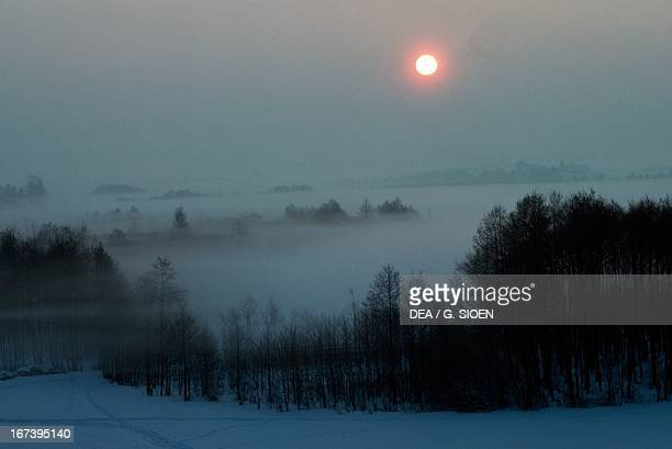 Sunset over low clouds in Masuria Poland
