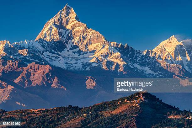 sunset over machapuchare seen from pokhara, nepal - annapurna conservation area stock photos and pictures