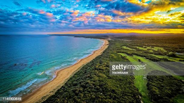 sunset over mallacoota - mallacoota stock pictures, royalty-free photos & images
