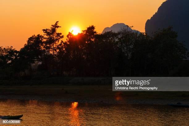 Sunset over Mekong river ind Vang Vienna, Laos