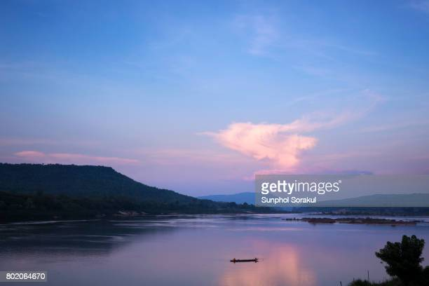 Sunset over Mekong river with Laos mountains in the background