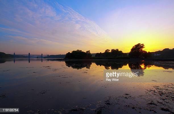 sunset over menai strait - menai bridge stock photos and pictures